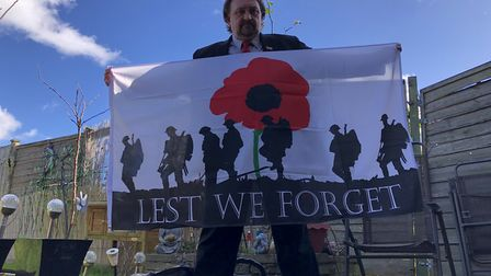 """Two flags bear the phrase """"Lest We forget"""" - but none of them have any logos or adverts. Babergh Dis"""