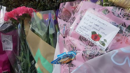A collection of floral tributes have been laid outside the home of Kia Russell and her son Kamari in