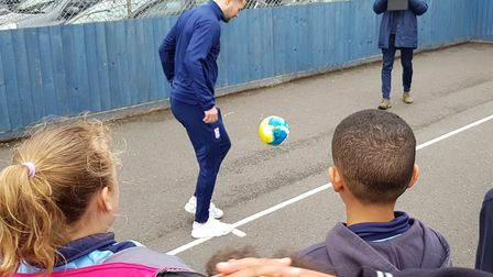 Ipswich Town winger Gwion Edwards showed off his skills at St Matthew's Primary School. Picture: RAC
