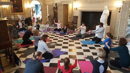 A busy family yoga session at Christchurch Mansion in Ipswich. Picture: RACHEL EDGE