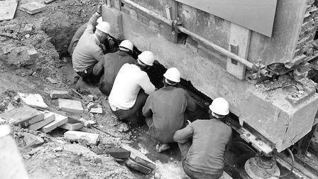 Engineers and builders on site as the Ragged School building was inched back in May 1984. Picture: O