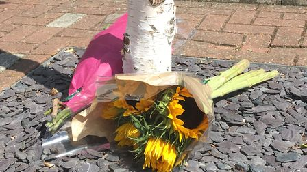 Flowers laid at the scene of the double deaths at Siloam Place. Picture: ARCHANT