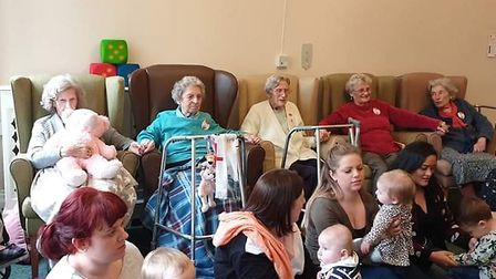 Mums, babies and residents enjoying themselves at one of the Jo Jingles Ipswich care home sessions a