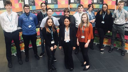 Some of the employees and students on apprenticeships, at the special Apprenticeship Week Event held