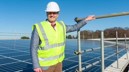 Paul Farrer, operations director at Haven Power, on the rooftop where solar panels have been install