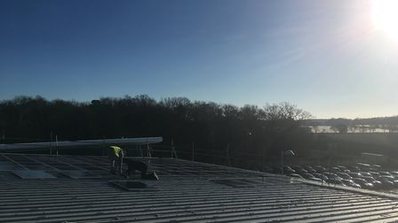 Solar panels being installed on the rooftop at Haven Power in Ipswich Picture: SARAH CHAMBERS