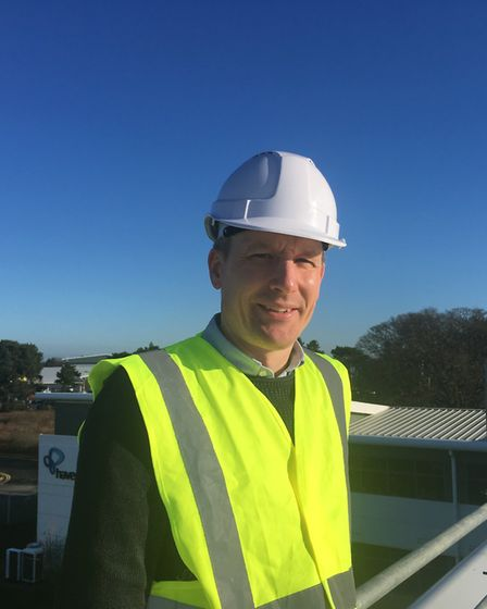 Tim Cole, head of brand and engagement on the roof at Haven Power, as solar panels are installed Pi