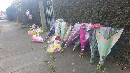 A collection of floral tributes have been laid outside the home of Kia Russell and her son Kamari on