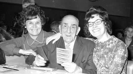 Two ladies congratulating an elderly man on his bingo victory! Picture: ARCHANT