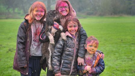 Tilly, Kelly, Lexi, Bobby Ambrose with their dog Luna at the Holi Festival Picture: SARAH LUCY BROW