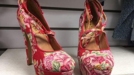 Unusual donated items at the new St Elizabeth Hospice shop - these amazing, floral high-heeled shoes