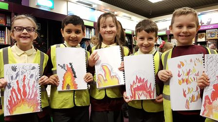 Pupils from Oaks Primary School drew pictures of fire in their books. Picture: RACHEL EDGE