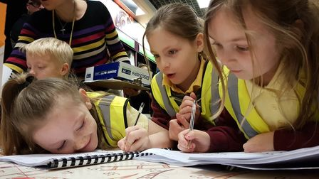Students from Oaks Primary School signed their books after the reading. Picture: RACHEL EDGE