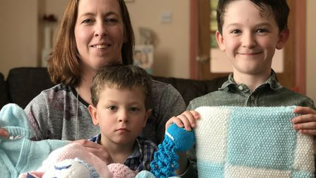 Vicky Osborne with her sons Charlie (right) and Freddie (centre) who was born prematurely at just 24