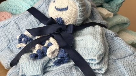 One of the beautifully knitted premature baby packs that Vicky Osbourne posts to parents across the