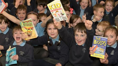 Pupils and staff celebrating the news that they have won the EADT Books for Schools competition Pic