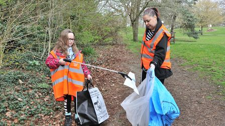 People collecting rubbish in Christchurch Park for the Great British Spring Clean. Picture: NICOLE D