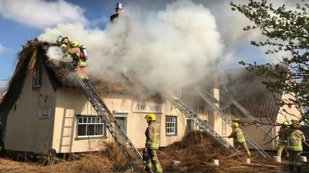 The fire has engulfed the thatched roof of The Ship Inn Picture: ARCHANT
