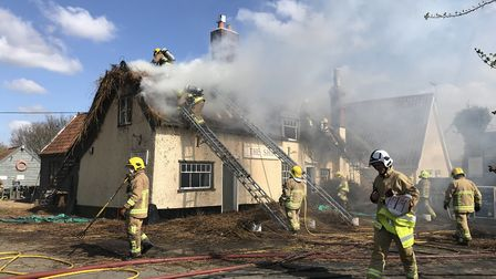 Crews are tackling a huge fire at The Ship Inn in Levington Picture: SARAH LUCY BROWN