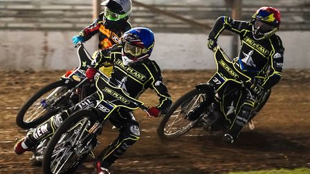 David Bellego leading Scott Nicholls and Chris Harris into the first corner in the opening heat. Pic