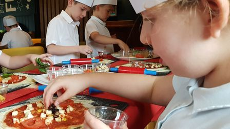 Pupils from Ravenswood Community Primary School chose which healthy toppings they would like to eat