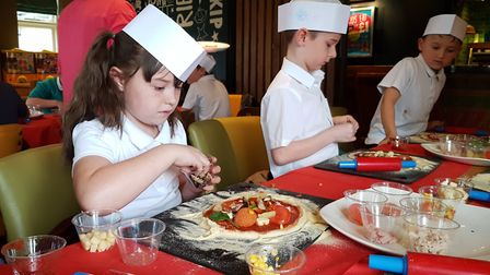 Pupils from Ravenswood Community Primary School made their own pizza in a healthy eating class at Th