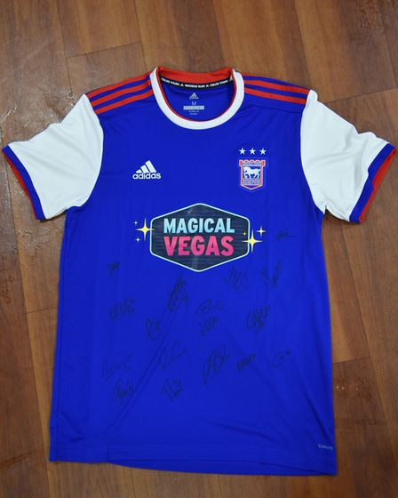 One shirt up for auction is a shirt signed by all of the current players at the club on a new home s