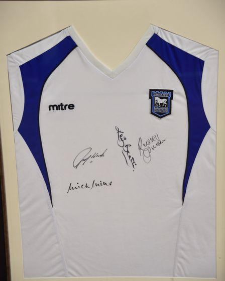 The shirt signed by Ipswich Town legends Kevin Beattie, Russell Osman, Mick Mills and John Wark Pict