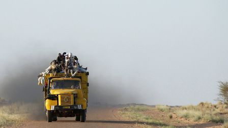 African migrants travel in the back of a truck across the Sahara Desert, near Agadez, Niger. Photo: