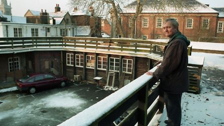 Charles Clarke, from Bethesda Church, Ipswich, at a snow covered former nightclub site in November 1