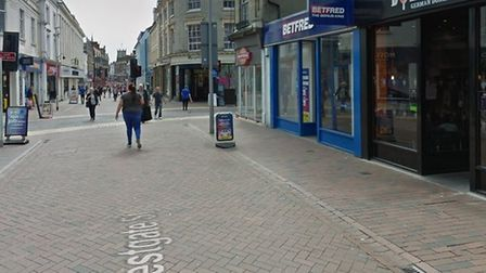 Suffolk police are looking to speak to the men, one of whom reportedly punched the woman in the face