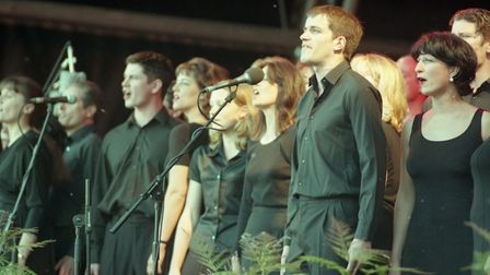 The Orchestrelle choir take to the stage to angelically sing to the crowds in the park Picture: JAM