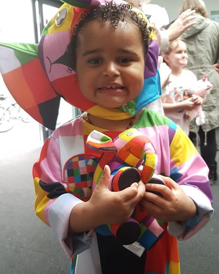 Two-year-old Rayna with her toy Elmer is looking forward to Elmer's Big Parade in Ipswich this Summe