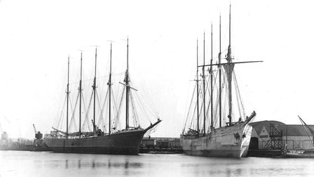 Sailing ships moored at Public Warehouse Quay on the island site around 1920 on either side of the o