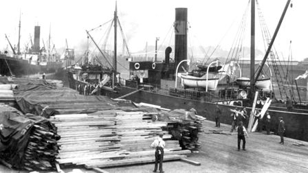 Timber being unloaded at Timber Quay in the 1920s Picture: IPSWICH MARITIME TRUST ARCHIVE