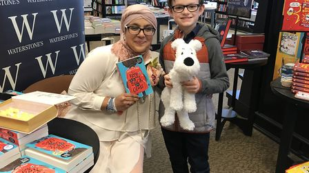 Onjali Q Rauf with nine-year-old Noah from Ipswich at her debut book signing for 'Boy at the Back of