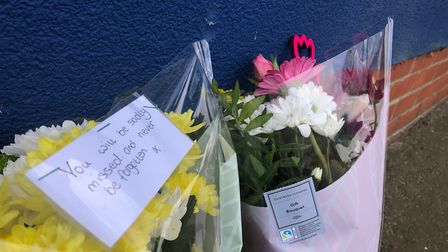 Students have left flowers for Holbrook Academy headteacher Dr Simon Letman, who died on April 13, a