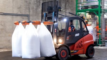 A forklift takes bags of fertiliser packed at the new bagging plant at ABP's Port of Ipswich Picture