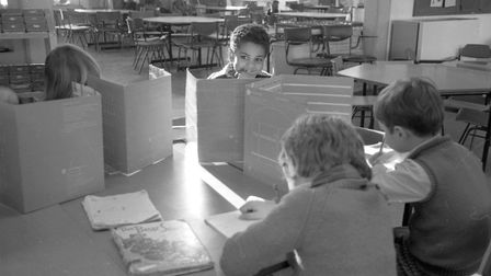 Pupils using big informatioin sheets for an classroom acitivity at Halifax school Picture: ARCHANT