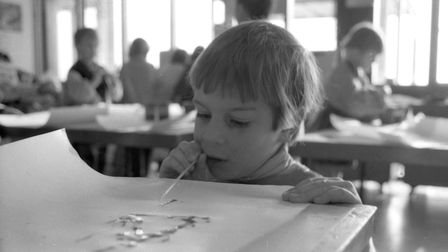 A young boy painting with a blow straw in an art class at Halifax school Picture: ARCHANT