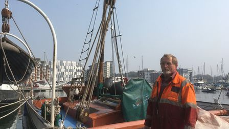 Skipper Gordon `Willie Williams on board the Ardwina, the last sailing barge to be built in Ipswich,