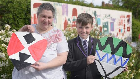 Sarah and Kadyn Woolven with their coat of arms for St Georges Day Picture: SARAH LUCY BROWN