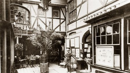 An Edwardian view of the interior court at the Great White Horse Hotel in Tavern Street, Ipswich. Lo