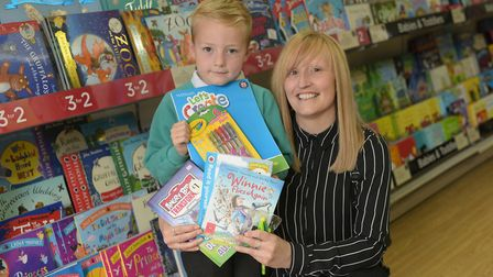 Connor Root with his mum Sarah at WH Smiths in Ipswich Picture: SARAH LUCY BROWN