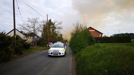 Police have cordoned off a large section of the road near to the fire at the old Fisons site in Bram