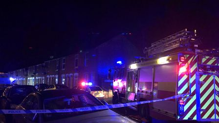 The police cordon in Cullingham Road was surrounded by officers by Suffolk Constabulary, firefighter