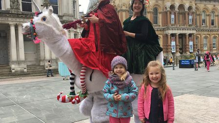 The unicorn and its riders with three-year-olds Thea and Erin Picture: ARCHANT