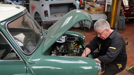 Ted Sparrow working on the mini at The East Anglian Mini Centre. Photo: Phil Morley.