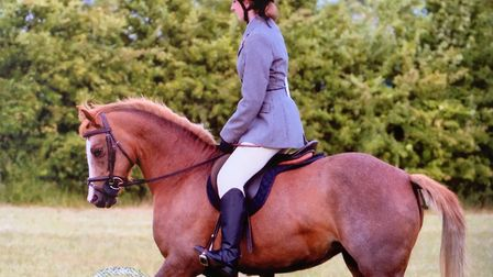 Julie had started riding at the age of nine. Horses became a major part of her life Picture: FAMIL