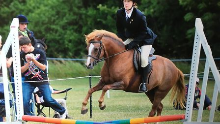Julie in action - and no tatty brown riding hat in sight... Picture: FAMILY COLLECTION